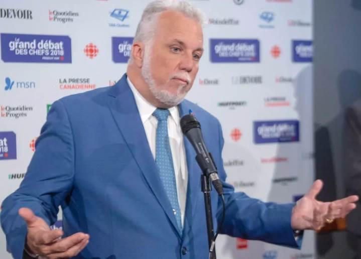 موقعی که بحث مهاجرت پیش آمد، فیلیپ کویارد از حزب لیبرال کبک، فرانسوآ لوگو را به ایجاد ترس و وحشت بین تازه مهاجران متهم کرد. Photo: Ryan Remiorz/Canadian Press